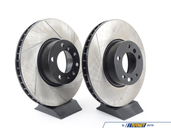 T#211049 - 34111159602GS - Gas-Slotted Brake Rotors (Pair) - Front - E39 540i (>3/2000), E31 840/850, E38 740i & 740il - Direct replacement FRONT gas-slotted brake discs. These rotors feature a unique black electro-coating that is designed to prevent corrosion. Each rotor is e-coated then double-ground and balanced to ensure an even surface with no vibration. The e-coating is the best anti-corrosion protection currently available in replacement rotors. Most aftermarket rotors are not coated, allowing surface rust to form right away, which is unattractive when brakes can be seen through your wheels. Slotting a rotor helps to release gases that build up between the rotor surface and an out-gassing brake pad. Without an escape, this thin layer of gas will cause a delay until the pad cuts through gas layer. The slots in our rotors allow the gases to escape giving better braking performance. For track and racing use, slotting is preferred over cross-drilling because the slots don't take away as much mass from the rotor and won't suffer from structural cracks. Sold as a FRONT pair. 324mm x 30mmThis item fits the following BMWs:1997-3/2000  E39 BMW 540i sedan & wagon1995-2001  E38 BMW 740i 740il 1990-1993  E31 BMW 850i 850ci 850csi - StopTech - BMW