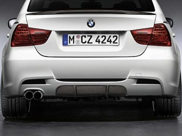T#1385 - 51122147973 - Genuine BMW Performance Carbon Fiber Rear Diffuser Insert - E90 - Real carbon fiber straight from BMW! Offset your BMW Performance Exhaust with this nicely enhanced look!  Dramatic exits come standard with this accessory. Only works in conjunction with the BMW Performance Aerodynamic Kit.This is just the insert that goes into the middle of the BMW Performance rear diffuser.   This is not the entire rear diffuser.This item fits the following BMWs:2006+  E90 BMW 325i 325xi 328i 328xi 328i xDrive 330i 330xi 335d 335i 335xi 335i xDrive - Sedan2006+  E91 BMW 325xi 328i 328xi 328i xDrive - Wagon  - Genuine BMW - BMW