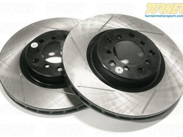 T#16451 - 34211166165GS - Gas-Slotted Brake Rotors (Pair) - Rear - E46 325xi - Direct replacement REAR gas-slotted brake discs for E46 325xi. These rotors feature a unique black electro-coating that is designed to prevent corrosion. Each rotor is e-coated then double-ground and balanced to ensure an even surface with no vibration. The e-coating is the best anti-corrosion protection currently available in replacement rotors. Most aftermarket rotors are not coated, allowing surface rust to form right away, which is unattractive when brakes can be seen through your wheels. Slotting a rotor helps to release gases that build up between the rotor surface and an out-gassing brake pad. Without an escape, this thin layer of gas will cause a delay until the pad cuts through gas layer. The slots in our rotors allow the gases to escape giving better braking performance. For track and racing use, slotting is preferred over cross-drilling because the slots don't take away as much mass from the rotor and won't suffer from structural cracks. Sold as a REAR pair.This item fits the following BMWs:2001-2005  E46 BMW 325xi - StopTech - BMW