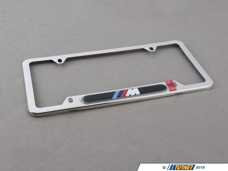 82120010405 License Plate Frame Silver Polished W M
