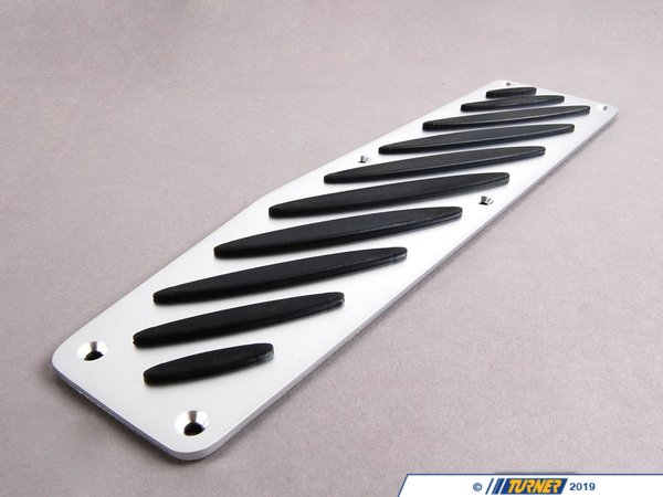T#3800 - 51470027792 - BMW M Performance Aluminum Dead Pedal/Footrest - E46, E82, E9X - Add comfort and great visual appeal to your interior with this BMW aluminum footrest cover. This dead pedal plate fits over the stock footrest (either over the stock plastic or replaces the original ///M plate). These are a perfect match to complete the upgrade of the factory BMW Performance pedal sets.This footrest features a brushed aluminum surface with raised rubber inserts. The kit includes the aluminum plate, flush-fit hardware, and drilling templates.This kit was originally designed to fit the E46, E82, and E90/E92 but it's also a great upgrade for many other BMW models (some trimming may be required on some models).This item fits the following left-hand drive BMWs:2008-2012  E82 BMW 128i 135i 1M Coupe1999-2005  E46 BMW 323i 323ci 325i 325ci 325xi 328i 328ci 330i 330ci 330xi M32006-2011  E90 BMW 325i 325xi 328i 328xi 328i xDrive 330i 330xi 335d 335i 335xi 335i xDrive M3 - Sedan2006-2012  E91 BMW 325xi 328i 328xi 328i xDrive - Wagon2007-2013  E92 BMW 328i 328xi 328i xDrive 335i 335is 335xi 335i xDrive M3 - Coupe2007-2013  E93 BMW 328i 335i M3 - Convertible - Genuine BMW M Performance - BMW