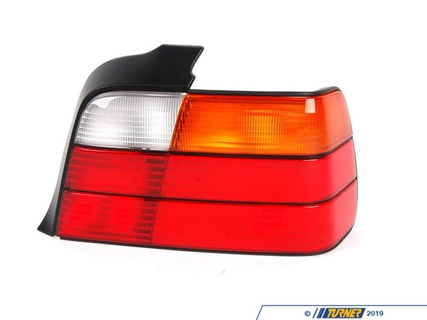 T#4776 - 63211393432 - Tail Light - Right - E36 4 Door - 325i 328i M3 - This is the right (passenger side) tail light assembly for E36 3 series 4 door Sedan models except 318i. This item fits the following BMWs:1992-1998  E36 BMW 325i 328i M3 - 4 Door Sedan - Genuine BMW - BMW