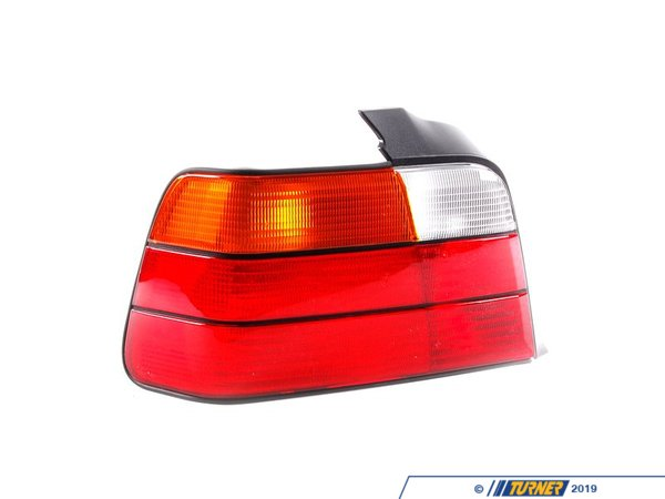 T#4775 - 63211393431 - Tail Light - Left - E36 4 Door - 325i 328i M3 - This is the left (drivers side) tail light assembly for E36 3 series 4 door Sedan models except 318i. This item fits the following BMWs:1992-1998  E36 BMW 325i 328i M3 - 4 Door Sedan - Genuine BMW - BMW