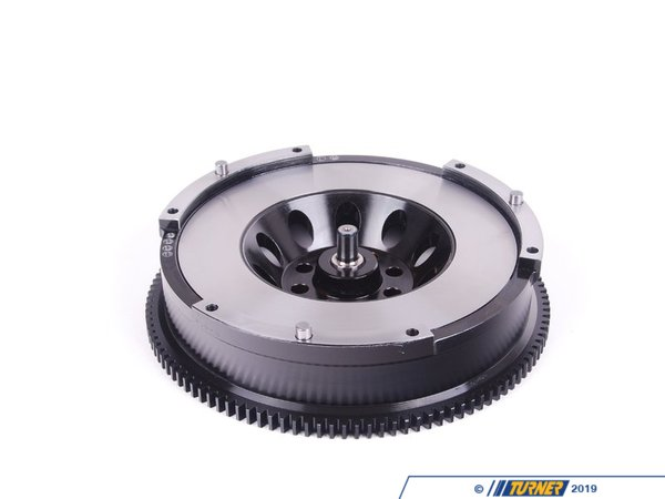 T#553672 - 000265TMS06 - Turner Motorsport Performance Lightweight Flywheel - N54 - E9x 335, E6x 535, E8x 135 - Engineered in-house, we designed this lightweight, single-mass flywheel to provide more than 10 pounds of weight savings over the factory flywheel. While some ultra-lightweight performance flywheels are manufactured from aluminum, our designers opted for a more driveable experience with steel. The mass provided by steel helps dampen vibrations and noise, delivering near-factory refinement with most of the benefits of a lightweight flywheel: quicker throttle response, improved durability (and longevity), and more effective transfer of power to the wheels.Modern flywheels are built with additional components that are designed to dampen and minimize vibrations from the engine and transmission. Weight has increased and reliability has decreased. With additional weight more energy is required for it to move. A lightweight flywheel does away with the dual mass design and its additional mass so more energy can be diverted to where it counts most - moving the car. The flywheel and clutch is one of the first areas that engine builders address when making the rotating assembly lighter for race engines. The dampening effect is just not needed on cars that are focused on performance. And with a single-mass flywheel the unreliable DMF design is eliminated.When it comes to selecting a clutch to pair with a lightweight flywheel, consider the driving youll be doing. As a single mass flywheel eliminates the dual-mass dampening of the factory flywheel, to retain the lowest noise, lowest harshness driving experience possible, select a clutch with a dampened disc. For dedicated track cars, a solid clutch hub is appropriate.*Click here for installation instructionsOur recommendations:Street: ACT Heavy DutyTrack: ACT Xtreme for high torque cars or OE 335is LuK (with 440lbs-ft or less)Features:Precision machined from 4140 HT heat treated chromoly steel for exceptional toughness, even wear properties, and durability.Material quality promotes even wear across the entire friction surfaceHeat treated to HRC 28-32, tempered to relieve stress and improve dimensional stability and elevated temperaturesHardness improves wear characteristicsBlack oxide coated for corrosion resistance on non-friction surfaces.8620 steel pilot bearing pin, case hardened and Precision ground for maximum wear resistance.Precision balanced to exceed OEM specification (G16 spec to 175g-mm).SFI 1.1 tested and certified to ensure safe operation under extreme operating conditionsSFI 1.1 specifies minimum material properties and requires a 3rd party lab certification test, spinning the flywheel to 1.5x redline for 1 hour to ensure the flywheel will not burst.Specifically designed to work with N54 architecture clutchesStep height designed to optimize clamp load and maximize the usable range of clutch wear for a long service lifePerformance:Turner Flywheel 18.6 lbs10 lbs lighter than the factory BMW flywheel (Stock Flywheel 28.9 lbs)Faster revsImproved throttle responseImproved accelerationSportier driving experienceStock flywheel weight - 28.9lbsTurner single mass flywheel weight = 18.55lbsThis item fits the following BMWs with 8bolt flywheel and build date up to 01/2009 or earlier:2008-01/2009 E82 BMW 135i 135is 1M2007-01/2009 E90 BMW 335i 335xi 335i xDrive - Sedan2007-01/2009 E92 BMW 335i 335is 335xi 335i xDrive - Coupe2007-01/2009 E93 BMW 335i 335is - Convertible2008-01/2009 E60 BMW 535i 535xi 535i xDrive - Turner Motorsport - BMW
