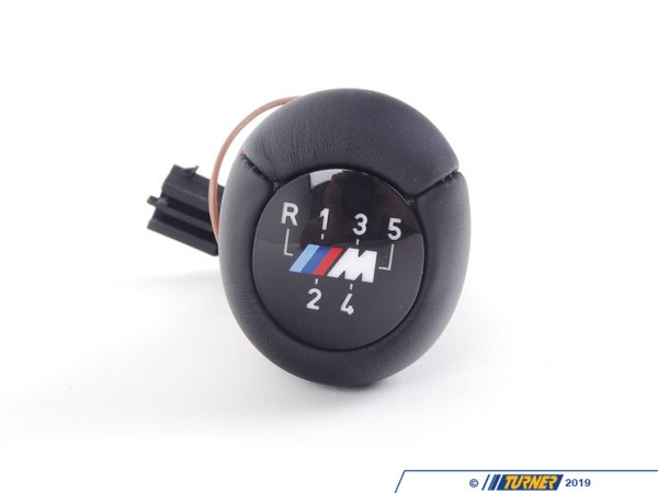 T#3208 - 25112231561 - Manual BMW Shift Knob (Illuminated) - E36 318/323/325/328/M3 - An Original BMW Part. This leather shift knob with M Stripes and 5 speed pattern connects to the factory wiring harness. Complete kit includes wiring harness and installation instructions. Red illumination matches the interior lighting and dims with dash illumination. This item fits the following BMWs:1992-1998  E36 BMW 318i 318is 318ti 318ic 323is 323ic 325i 325is 325ic 328i 328is 328ic M3 - Genuine BMW - BMW