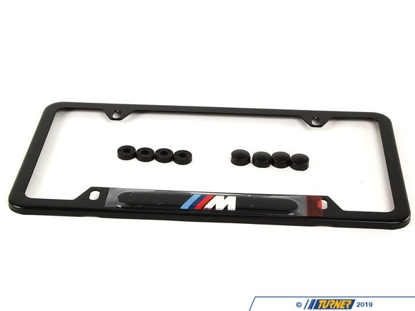 "T#1168 - 82120010404 - License Plate frame Black w/ M logo - This is a Black license plate frame with the BMW motorsport ""M"" logo. This Genuine Original BMW part is a great way to improve the looks of any BMW. The ""///M"" emblem is domed for a classy look. These are sold individually, so be sure to order two -- one for the front license plate, and one for the rear. - Genuine BMW - BMW"