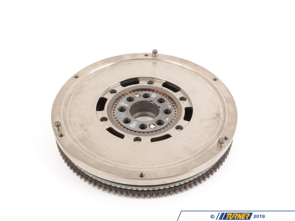 T#13218 - 21212227820 - Dual Mass Flywheel - E36 M3 95 (Genuine BMW) - This is the stock Genuine BMW twin mass flywheel for the 1995 E36 M3. Sachs recommends a new dual mass flywheel (DMF) on every other clutch replacement. There are several indicators for replacing the flywheel: damage to the clutch contact plate (from a severely worn clutch disc), grease leaking from inside (overheating), build-up of clutch material on the contact plate (excessive slipping and overheating), and failure of the internal damping system.The dampening system uses rubber or coil springs to absorb driveline vibrations. Through age, excessive heat, and aggressive use the rubber loses its resilience and the metal springs lose their strength and become brittle. If the clutch and flywheel have become overheated the internal grease may break down as well. A DMF failure can be massive and catastrophic, not to mention dangerous as bits of metal and rubber fling themselves through the transmission bellhousing. Heat and aggressive driving will accelerate the wear so race and track cars should have their stock flywheels replaced at regular intervals or with any new clutch. Even normal street cars should plan for a new flywheel if it has high mileage.DMF wear can only be checked with the transmission and clutch removed. If you can rotate the outer flywheel more than 20mm in either direction then it should be replaced.New flywheel mounting bolts must be ordered separately.This item fits the following BMWs:1995 E36 BMW M3 - Genuine BMW - BMW