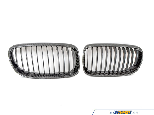 "T#2301 - BM-0222 - Carbon Fiber Center Grills - E90 Sedan 2009+ - Ditch the boring and overstated factory chrome front grilles and get a darker and more aggressive look on your car. These replacement grilles for the ""facelifted"" 2009 and newer E90 and E91 3 series sedan and wagon are made from ABS plastic core with a carbon fiber weave on the exterior frame. Carbon fiber is replacing chrome and aluminum as the most desired decorative trim. Since it has its roots in aerospace and motorsports the look gives off the impression of cutting-edge technology and lightness. But our suppliers have improved the fit and finish of carbons inherently rough appearance. There are several quality grades to carbon fiber weave and we would put this right in the middle. Its a good quality carbon weave without costing hundreds more like an Original BMW carbon part would. We inspect each grille for finish imperfections and quality issues so youre getting only the ones we approve. If you want to complete the carbon fiber makeover on your car check out our other carbon grilles, emblems, trim, and spoilers. But please note that we source our carbon products from multiple suppliers and the carbon pattern will vary. Our grilles are sold in pairs -- one for the left and one for the right. Installation is easy as they snap out and then snap back in.These Carbon Fiber Kidney Grills fit the following BMWs:2009-2011  E90 3 Series Sedan 328i, 328i xDrive, 335i, 335i xDrive, 335d 2009-2012  E91 3 Series Wagon 328i, 328i xDrive - ECS - BMW"