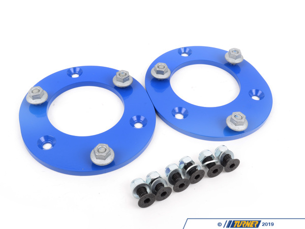 T#3553 - TSU3080459 - Turner Motorsport Street/Track Front Fixed Camber Plates - E24, E28, E30 - One of the tricks for getting your BMW to handle better is to add negative camber to the front wheels. This will put more of the tire's width in contact with the ground during cornering. With more rubber there is more grip. BMWs typically have less camber in the front to create understeer. But if you're running a stock setup on the track or autocross you are giving up speed and time as the front tires run out of grip sooner than they should.These fixed steel camber plates for your E30/E24/E28 will add 3/4 degree of negative camber and will reduce understeer during hard cornering and save the outside edge of your tire. These plates mount to the top of the upper strut bearing and relocate the top of the strut further in. Combine these with the BMW offset upper strut bearings for even more negative camber. These are the perfect camber solution when adjustable plates are not allowed in your class. We used these in our ultra-successful J-Stock suspension as they maximize the available camber in the tire well when using the large, stock-diameter springs.Instructions for Turner E30 Front Fixed Camber PlatesThis item fits the following BMWs:1984-1991  E30 BMW 318i 318is 318ic 325e 325es 325i 325ic 325is M3 - Turner Motorsport - BMW