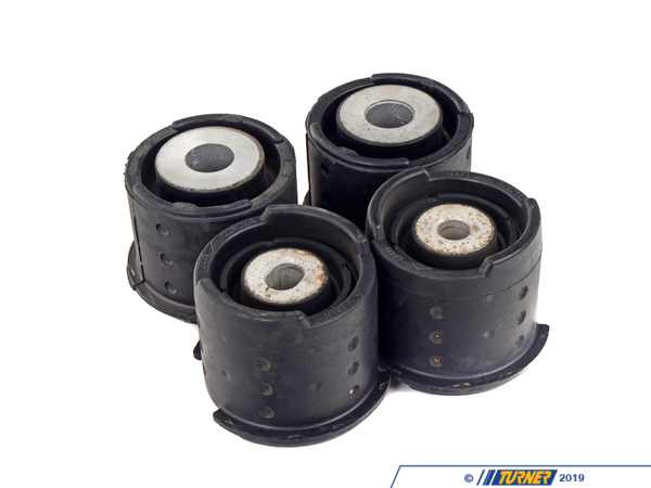 T#2051 - TMS2051 - Rear Subframe Bushings/Mount Set - Rubber - E46 M3, Z4 M - Any subframe work or reinforcement project on the rear of the E46 M3 should include a new set of subframe mounts. It's the worn rubber bushings that contribute to failed rear subframes on the E46 (but not the only reason). As the rubber gets worn, there is more flex to the mount. This flexing is then transferred to the sheetmetal in the floor where the spot welds will pop and the sheetmetal will crack. Additional force coming from stiffer suspensions and stickier tires will only increase the flexing of the mounts/chassis.Of course, stiffer mounts would help prevent this problem but with a stiffer bushing comes ride harshness, vibration, and additional noise. Our engineers and technicians recommend replacement with the factory rubber bushings (along with the appropriate reinforcement of the floor). The rubber bushings help isolate bumps and impacts and are quiet. They are also a perfect fitment and require no maintenance.This item is a set of 4 Original BMW rubber subframe mounts. Individual part numbers - 33 31 2 283 573 (left front), 33 31 2 283 574 (right front), and 33 31 2 283 419 (left and right rear, x 2).Applications:2001-2006 E46 M3, M3 CSL coupe, convertible2007-up Z4 M Roadster, M Coupe - Genuine BMW - BMW