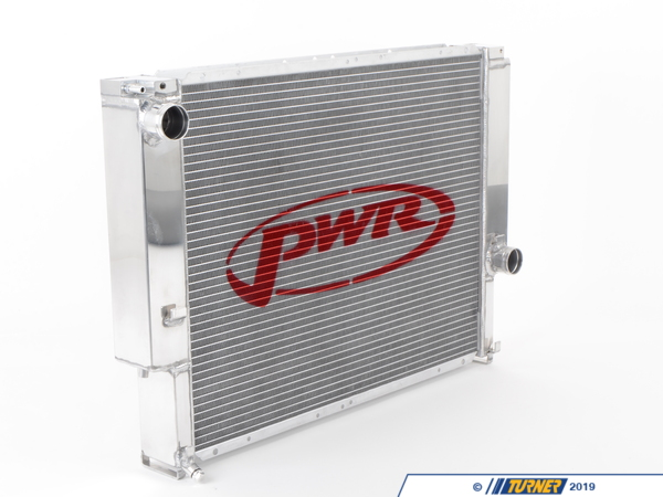T#3242 - PWR5533 - E36 PWR 55mm Aluminum Radiator Upgrade - This PWR radiator for the E36 325, 328, and M3 is a super-large 55mm core with a larger tank capacity for bulletproof cooling. If you're looking for the most complete and unbeatable radiator solution for your E36, this is the best we have seen. Everyone knows the E36 has an Achilles heal in the cooling system with flimsy radiator necks, plastic materials, unreliable water pumps, and not a lot of capacity for some applications. PWR has addressed some of these issues with the ultimate radiator. The 55mm core is a full 13-17mm thicker than the stock radiator. With minor adjusting during installation, all of the factory shrouds and fans will fit. Having a greater capacity means less saturation time for the cooling fluid which leads to more consistent engine temperatures, reducing wear and tear on other cooling components such as the water pump and thermostat. It's also hugely beneficial when using forced induction where increased underhood temperatures will snowball through the rest of the engine compartment and eventually the cooling system. Don't let your radiator end your race!Not only is this radiator larger, it's designed with the stresses of motorsports in mind. The cooling vanes use a unique oven brazed bonding technology that will not fatigue and crack like epoxyed construction. We have been more impressed with the fitment and quality of PWR over any other brand currently on the market. Aircraft-grade aluminum is used for the tanks and frame, which are TIG-welded for superior strength. The bottom of this radiator incorporates hangers which can be used to mount the stock Euro oil cooler or the TMS Oil Cooler Kit. We have used this on in-house and customer projects and it is a replacement for the stock E36 radiator, with all of the same hose locations and fittings as the original radiator. It mounts to the car with the original clips on the radiator support and the fan shroud/expansion tank bolts to the radiator (you will need to supply your own hardware as spacing and installing the shroud can be done several different ways). But because this is an extra large version of the stock radiator some manual adjusting and fitment care will be required. Professional installation is not required but may be necessary. Each radiator is pressure-tested during manufacturing. Because of the extra depth required between the radiator and engine, extra care will be needed when installed with forced induction kits, non-stock oil coolers, and lines.PWR is a world-renowned radiator manufacturer, supplying all forms of motorsport from Formula One (2010 World Champion Sebastian Vettel) to WRC to NASCAR. Our TMS Race Team uses PWR for our cooling needs in the Rolex GT and Continental Sports Car series.E36 PWR Aluminum Radiator Applications:1992-1995 E36 325i, 325is, 325ic1996-1999 E36 323is, 323ic, 328i, 328is, 328ic1995-1999 E36 M3 (US model)1994-1999 E36 Euro M3 (requires oil cooler hangers - click here) - PWR - BMW