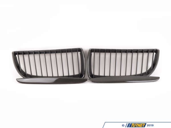 T#1402 - BM-0064 - Carbon Fiber Center Grills - E90 3 Series 4 Door 2006-2008 - These direct replacement center grills let you eliminate the stock chrome kidney/center grills, feature perfect fit and beautiful finish, and give a darker more aggressive look to your E90 3 seriessedan, 2006-2008. Includes two black grills and two hood trims.Made from impact resistant long life ABS polymer, these grills are precision crafted for a perfect OEM fit. Unlike some competitors blacked-out grills which have a shiny finish that give off a cheap look and feel, these black grills feature a high quality matte finish reminiscent of genuine BMW parts.This item fits the following BMWs:2006-2008E90 BMW325i 325xi 328i 328xi 328i xDrive 330i 330xi 335d 335i 335xi 335i xDrive - Sedan2006-2008E91 BMW325xi 328i 328xi 328i xDrive - Wagon - ECS - BMW