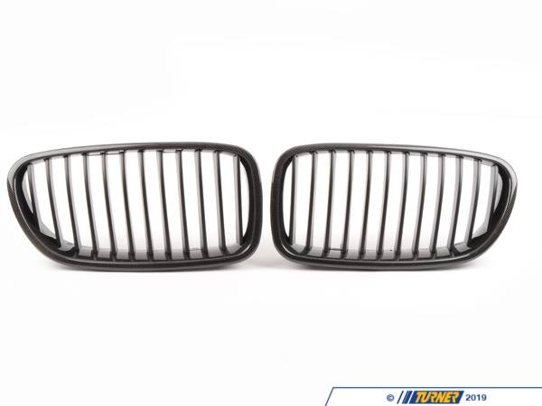 T#5663 - BM-0067-CF - Carbon Fiber Center Grills - F10 528i 535i 550 M5 2011-2013 - Ditch the boring and overstated factory chrome front grilles and get a darker and more aggressive look on your car. These replacement grilles are made from ABS plastic with a carbon fiber weave on the exterior frame. Carbon fiber is replacing chrome and aluminum as the most desired decorative trim. Since it has its roots in aerospace and motorsports the look gives off the impression of cutting-edge technology and lightness. But our suppliers have improved the fit and finish of carbons inherently rough appearance. There are several quality grades to carbon fiber weave and we would put this right in the middle. Its a good quality carbon weave without costing hundreds more like an Original BMW carbon part would. We inspect each grille for finish imperfections and quality issues so youre getting only the ones we approve. If you want to complete the carbon fiber makeover on your car check out our other carbon grilles, emblems, trim, and spoilers. But please note that we source our carbon products from multiple suppliers and the carbon pattern will vary. Our grilles are sold in pairs  one for the left and one for the right. Installation is easy as they snap out and then snap back in.This item fits the following BMWs:2011-2013  F10 BMW 528i 535i 535i xDrive 550i 550i xDrive M5Not for cars with Night Vision option. - ECS - BMW