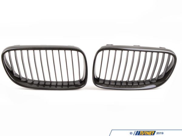 T#3247 - BM-0242 - Carbon Fiber Center Grills - E92 E93 03/2010+ (except M3) - Ditch the boring and overstated factory chrome front grilles and get a darker and more aggressive look on your car. These replacement grilles are made from ABS plastic with a carbon fiber weave on the exterior frame. Carbon fiber is replacing chrome and aluminum as the most desired decorative trim. Since it has its roots in aerospace and motorsports the look gives off the impression of cutting-edge technology and lightness. But our suppliers have improved the fit and finish of carbons inherently rough appearance. There are several quality grades to carbon fiber weave and we would put this right in the middle. Its a good quality carbon weave without costing hundreds more like an Original BMW carbon part would. We inspect each grille for finish imperfections and quality issues so youre getting only the ones we approve. If you want to complete the carbon fiber makeover on your car check out our other carbon grilles, emblems, trim, and spoilers. But please note that we source our carbon products from multiple suppliers and the carbon pattern will vary. Our grilles are sold in pairs  one for the left and one for the right. Installation is easy as they snap out and then snap back in.This item fits the following BMWs:3/2010+  E92 BMW 328i 328xi 328i xDrive 335i 335is 335xi 335i xDrive3/2010+  E93 BMW 328i 335i - ECS - BMW