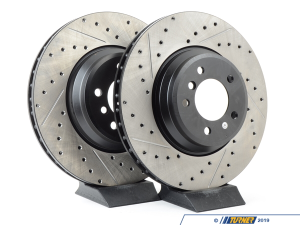 T#12039 - 34116770729CDS - Cross-Drilled & Slotted Brake Rotors - Front - E9X 335i/335Xi (pair) - Slotting a rotor helps to release gases that build up between the rotor surface and an out-gassing brake pad. Without an escape, this thin layer of gas will cause a delay until the pad cuts through gas layer. The slots in our rotors allow the gases to escape giving better braking performance. Cross-drilling a rotor is a way to improve initial pad bite. With the additional leading edges at each hole, the pad is able to grab the rotor just a little bit harder. By combining both Cross-drilling and slotting, these rotors combine the best of both worlds. Fewer holes mean longer pad life with little penalty in the way of initial pad bite. These rotors feature a unique black electro-coating that is designed to prevent corrosion. Each rotor is e-coated then double-ground and balanced to ensure an even surface with no vibration. The e-coating is the best anti-corrosion protection currently available in replacement rotors. Most aftermarket rotors are not coated, allowing surface rust to form right away, which is unattractive when brakes can be seen through your wheels. These front brake discs / brake rotors fit:2007-2010 E90 335i, 335Xi sedan2007-2010 E92 335i, 335Xi coupe2007-2010 E93 335i, 335Xi convertible - StopTech - BMW