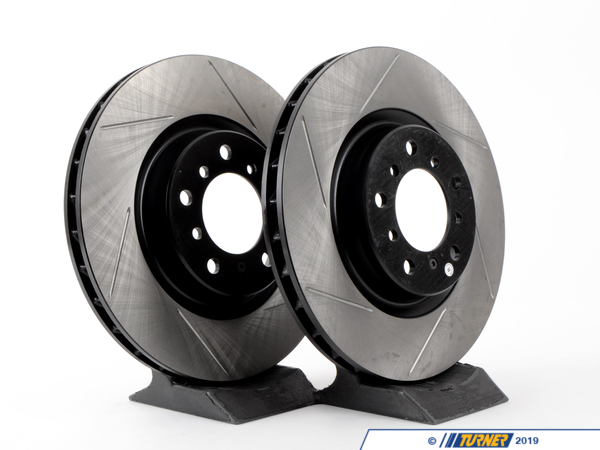 T#1391 - TMS1391 - Gas-Slotted Brake Rotors (Pair) - Front - E46 M3 - Direct replacement Front gas-slotted brake discs for E46 M3 (except CSL/ZCP brakes). These rotors feature a unique black electro-coating that is designed to prevent corrosion. Each rotor is e-coated then double-ground and balanced to ensure an even surface with no vibration. The e-coating is the best anti-corrosion protection currently available in replacement rotors. Most aftermarket rotors are not coated, allowing surface rust to form right away, which is unattractive when brakes can be seen through your wheels. Slotting a rotor helps to release gases that build up between the rotor surface and an out-gassing brake pad. Without an escape, this thin layer of gas will cause a delay until the pad cuts through gas layer. The slots in our rotors allow the gases to escape giving better braking performance. For track and racing use, slotting is preferred over cross-drilling because the slots don't take away as much mass from the rotor and won't suffer from structural cracks. Sold as a FRONT pair.This item fits the following BMWs:2001-2006  E46 BMW M3, M3 ConvertibleNot for M3's with ZCP/CSL brakes - StopTech - BMW