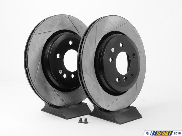 T#3576 - 34201166073GS - Gas-Slotted Brake Rotors (Pair) - Rear - E46 330i/Ci - Direct replacement REAR gas-slotted brake discs for E46 330i/ci/xi. These rotors feature a unique black electro-coating that is designed to prevent corrosion. Each rotor is e-coated then double-ground and balanced to ensure an even surface with no vibration. The e-coating is the best anti-corrosion protection currently available in replacement rotors. Most aftermarket rotors are not coated, allowing surface rust to form right away, which is unattractive when brakes can be seen through your wheels. Slotting a rotor helps to release gases that build up between the rotor surface and an out-gassing brake pad. Without an escape, this thin layer of gas will cause a delay until the pad cuts through gas layer. The slots in our rotors allow the gases to escape giving better braking performance. For track and racing use, slotting is preferred over cross-drilling because the slots don't take away as much mass from the rotor and won't suffer from structural cracks. Sold as a REAR pair. - StopTech - BMW
