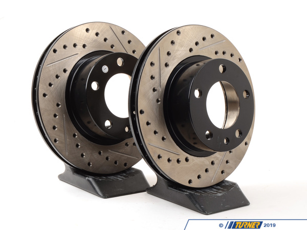 T#211046 - 34111153228CDS - Cross-Drilled & Slotted Brake Rotors - Front - E28 535i/is - E24 635csi (Pair) - Slotting a rotor helps to release gases that build up between the rotor surface and an out-gassing brake pad. Without an escape, this thin layer of gas will cause a delay until the pad cuts through gas layer. The slots in our rotors allow the gases to escape giving better braking performance. Cross-drilling a rotor is a way to improve initial pad bite. With the additional leading edges at each hole, the pad is able to grab the rotor just a little bit harder. By combining both Cross-drilling and slotting, these rotors combine the best of both worlds. Fewer holes mean longer pad life with little penalty in the way of initial pad bite. These rotors feature a unique black electro-coating that is designed to prevent corrosion. Each rotor is e-coated then double-ground and balanced to ensure an even surface with no vibration. The e-coating is the best anti-corrosion protection currently available in replacement rotors. Most aftermarket rotors are not coated, allowing surface rust to form right away, which is unattractive when brakes can be seen through your wheels. This item fits the following BMWs:1985-1988  E28 BMW 535i 535is1984-1989  E24 BMW 635csi - StopTech - BMW