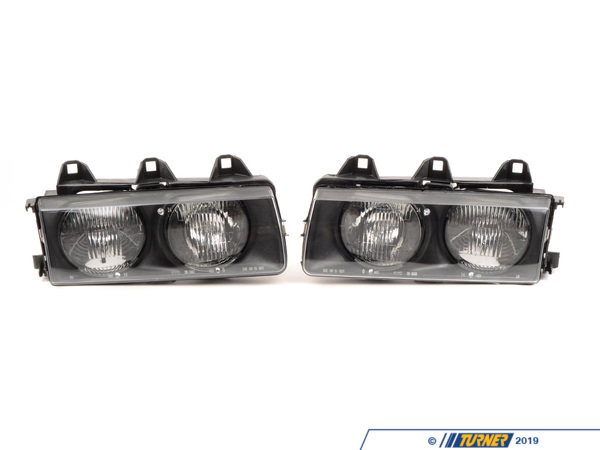 TYC E36 1992-99 Replacement Headlight Housings (pair) 63121387863