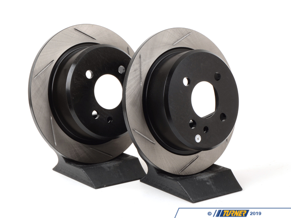 T#16469 - 34216755407GS - Gas-Slotted Brake Rotors (Pair) - Rear - E30 318, 325e/I - Direct replacement REAR gas-slotted brake discs for the E30 325e 325es 325i 325is 325ix 318is 318ic. These rotors feature a unique black electro-coating that is designed to prevent corrosion. Each rotor is e-coated then double-ground and balanced to ensure an even surface with no vibration. The e-coating is the best anti-corrosion protection currently available in replacement rotors. Most aftermarket rotors are not coated, allowing surface rust to form right away, which is unattractive when brakes can be seen through your wheels. Slotting a rotor helps to release gases that build up between the rotor surface and an out-gassing brake pad. Without an escape, this thin layer of gas will cause a delay until the pad cuts through gas layer. The slots in our rotors allow the gases to escape giving better braking performance. For track and racing use, slotting is preferred over cross-drilling because the slots don't take away as much mass from the rotor and won't suffer from structural cracks. Sold as a REAR pair.This item fits the following BMWs:1990-1991  E30 BMW 318i 318is 318ic 1984-1991  E30 BMW 325e 325es 325i 325ic 325is  - StopTech - BMW