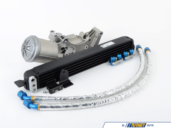 T#1382 - TMS1382 - E36 323/325/328/M3 Turner Motorsport Oil Cooler Kit - Stage 2 with Euro Oil Cooler - The TMS Stage 2 Oil Cooler Kit takes the benefits of the factory oil cooler and housing in Stage 1 and adds the TMS-exclusive HTP oil lines. This makes it possible to use the factory oil cooler with a supercharger or a racing alternator pulley. This is possible because the oil lines are routed away from the front of the alternator and alternator pulley. The TMS Stage 2 Oil Cooler Kit uses mostly factory BMW parts to maintain the same clean appearance and performance you would expect if it was installed by the factory. The HTP lines (High Temperature Polymer Braided) oil lines are better than a rubber or stainless steel line. They are non-abrasive, unlike stainless lines, so they wont cut into power steering or coolant hoses. Our Kit works on all US-spec 6-cylinder E36 BMWs with the S52 engine. All components included with the TMS Stage 2 Oil Cooler Kit bolt or clip into place with only a slight modification to the alternator cooling tube (only required on particular models). By providing essential hardware with this kit the final result is a hassle-free installation for you, making this an ideal kit for a street/track car. This kit can be fitted to any US spec 6 cylinder E36 BMW, including M3, 325i, 325is, 328i, 328is, and 323is (sedan, coupe and convertible).This oil cooler system incorporates the Euro M3 oil filter housing which has ports for the delivery and return lines of the oil cooler. The internal pathways of the filter housing are designed for the oil to flow out of the housing, into the cooler, and then return to the housing. The US housing is not setup for any of this, as the oil just runs straight into the filter and onto the engine. Also, the Euro housing has an integrated thermostat to bypass the cooler at lower temps (who needs cold oil when the engine is cold?). We use the system from the Euro E36 M3, so all parts are guaranteed to fit and look as it would, had the car left the factory with it installed.  Our products are engineered to work as a complete system, we do not take shortcuts  no leaks, no fitment problems, and as always superior performance. Parts included: Original BMW oil cooler (from the Euro E36 M3), TMS custom built HTP oil lines with -10 fittings, 2 AN-10 oil line adaptor kits, a BMW Euro E36 oil filter housing (properly modified to accept the US banjo style fitting of the VAN0S oil line), brackets to mount the cooler to the bottom of the stock radiator (TMS exclusive!), and instructions. - Turner Motorsport - BMW