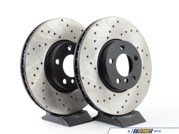 T#12152 - 34116771985CD - Cross-Drilled Brake Rotors - Front - E70 X5 3.0si, xDrive30i, E71 X6, F15 X5, F16 X6 - Direct replacement Front cross-drilled brake discs for the E70 X5 3.0si. These rotors feature a unique black electro-coating that is designed to prevent corrosion. Each rotor is e-coated then double-ground and balanced to ensure an even surface with no vibration. The e-coating is the best anti-corrosion protection currently available in replacement rotors. Most aftermarket rotors are not coated, allowing surface rust to form right away, which is unattractive when brakes can be seen through your wheels.A cross-drilled rotor helps to release gases that build up between the rotor surface and an out-gassing brake pad. Without an escape, this thin layer of gas will cause a delay until the pad cuts through gas layer. The holes in our rotors allow the gases to escape giving better braking performance.This item fits the following BMWs:2007-2013  E70 BMW X5 3.0si X5 Drive30i X5 xDrive35i2014+  F15 BMW X5 sDrive35i X5 xDrive35d X5 xDrive35ii2011-2014  E71 BMW X6 xDrive35i2015+  F16 BMW X6 sDrive35i X6 xDrive35i - StopTech - BMW