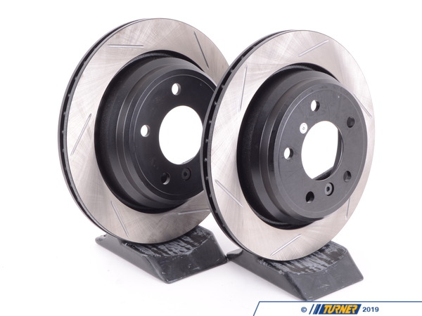 T#3064 - 34211164840GS - Gas-Slotted Brake Rotors (Pair) - Rear - E39 525i 528i 530i 540i - Direct replacement REAR gas-slotted brake discs for E39 (except M5). These rotors feature a unique black electro-coating that is designed to prevent corrosion. Each rotor is e-coated then double-ground and balanced to ensure an even surface with no vibration. The e-coating is the best anti-corrosion protection currently available in replacement rotors. Most aftermarket rotors are not coated, allowing surface rust to form right away, which is unattractive when brakes can be seen through your wheels. Slotting a rotor helps to release gases that build up between the rotor surface and an out-gassing brake pad. Without an escape, this thin layer of gas will cause a delay until the pad cuts through gas layer. The slots in our rotors allow the gases to escape giving better braking performance. For track and racing use, slotting is preferred over cross-drilling because the slots don't take away as much mass from the rotor and won't suffer from structural cracks. Sold as a REAR pair.This item fits the following BMWs:1997-2003  E39 BMW 525i 528i 530i 540i - StopTech - BMW