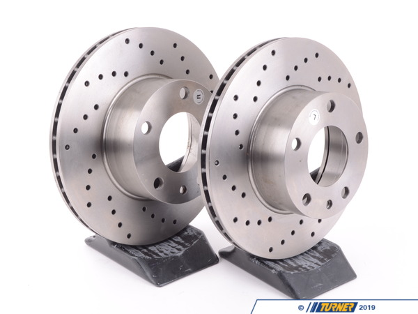 T#176957 - 34111163130CD - Cross-Drilled Brake Rotors - Front - E12, E23, E24 (pair) - StopTech - BMW