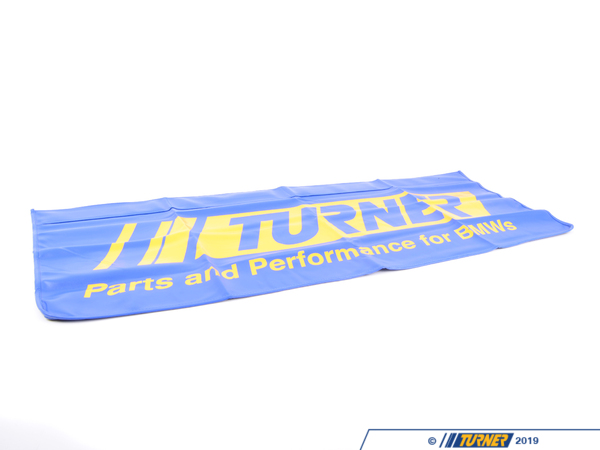 "T#390157 - 019744TMS01A - Turner Magnetic Fender Cover - Protect your finish when working under the hood with a high quality Turner fender cover. Made from a synthetic leather layer with a goose flannelette backing for durability and protection. The Turner fender cover holds a tight grip to your fender or core support with four 9.5"" magnets sewn into the top layer.Features:Durable synthetic leather with the Turner logoSoft goose flannelette backingFour 9.5"" integrated magnetsDimensions:Extra Long 20"" x 47"" - Schwaben - BMW MINI"