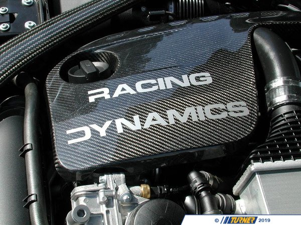 T#554683 - 1317455020 - Racing Dynamics Carbon Fiber Engine Cover - F80 F82 F83 M3 M4 - Racing Dynamics' Carbon fiber engine cover will add some style to the bay of your M3 or M4.Racing Dynamics been influential in the European car community since the 1980s. Known for sway bars and strut braces developed from pure professional experience, utilizing the expertise of skilled race engineers to develop or improve products to meet the demands of BMW drivers. Racing Dynamics is never lacking in the quality department, and that is no exception for their S55 engine cover. - Racing Dynamics - BMW