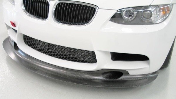 "T#4422 - GT4-SPLITTER - E9X M3 Genuine BMW Motorsport GT4 Front Splitter - Ultra-rare BMW Motorsport Racing part! This front splitter was optional equipment on the M3 GT4, a production-based race car built and sold by BMW Motorsport for the European GT4 race series. This front splitter is the REAL DEAL -- a true racing part that designed to add substantial downforce to the front end of the E9X chassis M3. As the M3 GT4 still used the same stock front bumper cover as your typical M3 street car, this splitter can be added to ANY 2008 or newer BMW M3. Made of 100% carbon fiber, this front splitter includes fully functional brake duct openings for maximum cooling.  As this is a true race part, made in very small numbers, the cost from BMW Motorsport reflects this -- but if you need a fully developed front splitter that was engineered by BMW Motorsport (and not just some ""guess and test"" styling piece) this is the splitter you want. This item fits the following BMWs:2008+  E90 M3 sedan2008+  E92 M3 coupe2008+  E93 M3 convertible - Genuine BMW - BMW"