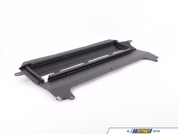 T#397557 - 021491TMS01A-02 - Turner Motorsport Skid Plate - Wrinkle Black Powdercoat Finish - F80 M3, F82/83 M4 - Since the F8x M3/M4 was designed to make impressive power in stock form (and loads more with upgrades) these cars feature some heavy duty cooling hardware. In order to keep oil temperatures down (something many late model M cars have struggled with) requiresa large oil cooler. BMW engineers positioned the oil cooler quite low under the car, positioned horizontally -an aerodynamic design which creates avacuum force while driving,drawingheat from the oil cooler. The issue some of the vehicle owners have experienced is road debris from small branches to chunks of ice have impacted the OE belly pan hard enough to crack the oil cooler draining the cars oil rapidly. Being one of the lowest points of the car, even a close encounter with a parking block can mean the end of the road for the factory belly pan - and oil cooler. Damage to the belly pan means reduced cooling, which can result in dangerously high engine temperatures. Once the belly pan is damaged, there is no longer any protection for the oil cooler, meaning damage to the cooler and a catastrophic loss in oil pressure may be right around the corner.The lightweight Turner skid plate comes in just 3 lbs heavier than stock with a total weight of just 5 lbs - additional poundage that is a valuable addition. Designed using 8 gauge5052 aluminum, this skid plate offersplenty of strength to protect your oil cooler. We also made sure this would be an easy, reversible upgrade by maintaining OE mounting locations and hardware that requires NO cutting or modification to your vehicle for fitment. Our engineering team also felt it was important to maintain some of the cooling features the BMW engineers spec'd out such as having a trim seal to fit snugly against the cooler edges to create the same vacuum cooling effects as stock.Features:In-house designed to maintain OEcooling and fitmentManufactured from 8 gauge5052 aluminumMaintains factory hardware and mounting pointsNo cutting, drilling, or modification required5 lbs total weight, only 3 lbs more than the plastic OEMade in America!If new factory hardware is required, use part number07149126886. 11 required in total to secure this skid plate. - Turner Motorsport - BMW