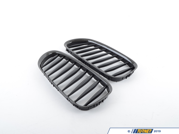 T#257 - BM-0218 - Carbon Fiber Center Grills - E85 E86 Z4 2004-2008 - These direct replacement center grills let you eliminate the stock chrome kidney/center grills, feature perfect fit and beautiful finish, and give a darker more aggressive look to your Z4. Includes left and right front kidney black grills.Made from impact resistant long life ABS polymer, these grills are precision crafted for a perfect OEM fit. Unlike some competitors blacked-out grills which have a shiny finish that give off a cheap look and feel, these black grills feature a high quality matte finish reminiscent of genuine BMW parts.These Carbon Fiber Kidney Grills fit the following BMWs:2004-2008  E85 Z4 Roadster Z4 2.5i, Z4 3.0i, Z4 3.0si, Z4 M Roadster2004-2008  E86 Z4 Coupe Z4 3.0si, Z4 M Coupe - ECS - BMW
